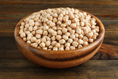 Chickpeas in a wooden bowl Royalty Free Stock Image