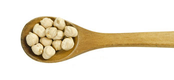 Chickpeas in a wooden spoon Royalty Free Stock Photography