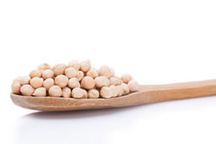 Chickpeas in a wooden spoon Stock Photos