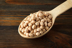 Chickpeas in a wooden spoon Stock Photography