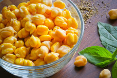 Chickpeas  on the wooden surface and basil Stock Photo
