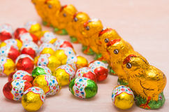 Chicks and chocolate eggs for Easter holidays Stock Photos