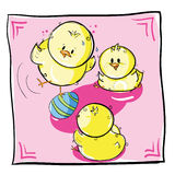 Chicks playing with easter egg Stock Images
