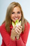 Chicory. Young happy woman with fresh chicory stock image