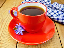 Chicory drink in red cup with napkin and flower Royalty Free Stock Images