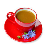 Chicory drink in red cup on saucer. Chicory drink in a red cup with a flower on a saucer with a light shade on white background Royalty Free Stock Image