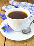 Chicory drink in white cup with flower on board Royalty Free Stock Photos
