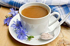 Chicory drink in white cup with flower on board Royalty Free Stock Image