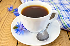 Chicory drink in white cup with flower and napkin Royalty Free Stock Image
