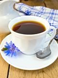 Chicory drink in white cup with milkman on board Royalty Free Stock Images
