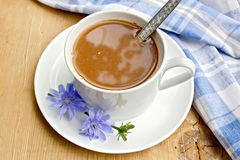 Chicory drink in white cup with spoon on board Stock Photography