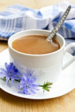 Chicory drink in white cup with spoon and flower Stock Photo