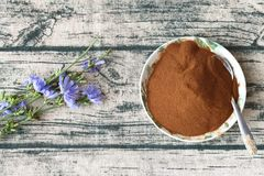Chicory powder and flowers royalty free stock photos