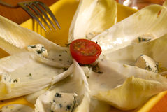 Chicory salad. With blue cheese dressing Royalty Free Stock Photos