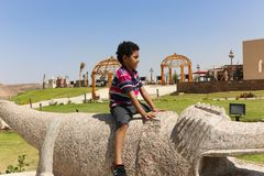 Chid play in African park. 20 September 2017 Arts inside African park at Aswan, Egypt Stock Photos