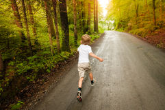 Chid run in the forest Royalty Free Stock Image