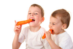 Chidren with carrot. On a white background Royalty Free Stock Photography