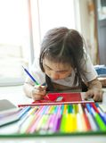 Chidren color pencil drawing in home living room royalty free stock photography