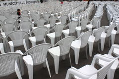 Child playing among empty seats Royalty Free Stock Photo