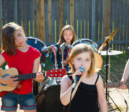Chidren singer girl singing playing live band in backyard Stock Photography