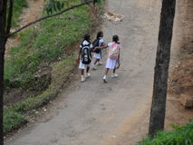 Chidren to the school. A train ride to up country Sri Lanka. The train is passing through a beautiful scenary. passengers are enjoying the ride Royalty Free Stock Images