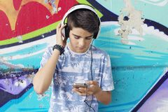 Chidren wity mobile phone. On street, lifestyle and technology Stock Photography