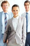 Chief ad her workers Royalty Free Stock Image