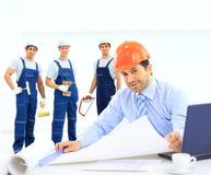 Chief architect and his team Royalty Free Stock Photos