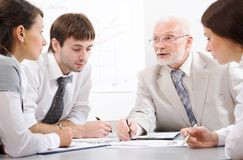 Chief and assistants. The skilled chief trains the assistants royalty free stock images