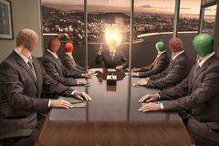 Men with match heads on shoulders hold a production meeting royalty free stock photography