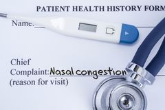 Chief complaint nasal congestion. Paper patient health history form, on which is written the complaint nasal congestion as the mai stock photos