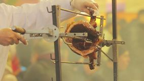 Chief cook cutting a piece of roasted pig. Unhealthy food, greasy meat. Stock footage stock video