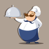 Chief cook with delicious dish Royalty Free Stock Photography