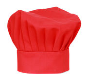 Chief cook hat. Red chief cook hat isolated on white royalty free stock photo