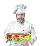 Chief cook holding big sandwich Royalty Free Stock Images