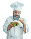 Chief cook  holding  big sandwich Royalty Free Stock Image