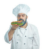 Chief cook  holding  big sandwich Royalty Free Stock Photography