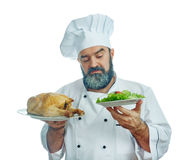 Chief cook  holding  Fried chicken and vegetables. Stock Photo