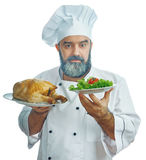 Chief cook  holding  Fried chicken and vegetables. Stock Photography