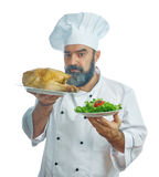 Chief cook  holding  Fried chicken and vegetables. Royalty Free Stock Image