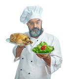 Chief cook  holding  Fried chicken and vegetables. Stock Images