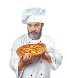 Chief cook holding pizza napoletana Royalty Free Stock Image