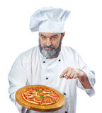 Chief cook holding pizza napoletana Stock Images