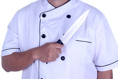 Chief cook with knife in his hand Stock Photo