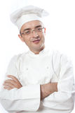 Chief cook looking over glasses. Over white Stock Image