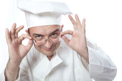 Chief cook looking over glasses. Over white Royalty Free Stock Photos