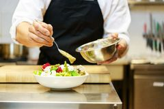 Chief cook preparing salad Royalty Free Stock Image