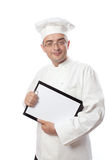 Chief cook showing menu Royalty Free Stock Photo