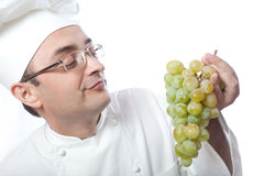 Chief cook and white grape Stock Photos