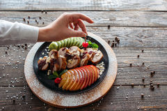 Chief decorated baked veal with fresh cherry Royalty Free Stock Photography